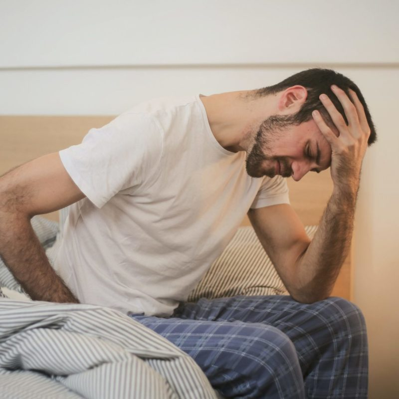 Man in bed with hip pain